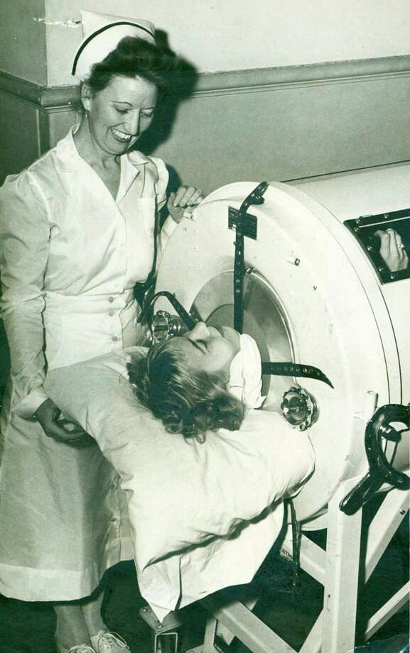 Della Barron, 17 in 1948, contracted polio; she spent nearly two weeks in an iron lung at Robert B. Green Hospital. At her side is Supervisor Josephine Ricks. Photo: File Photo /San Antonio Express-News / San Antonio Express-News