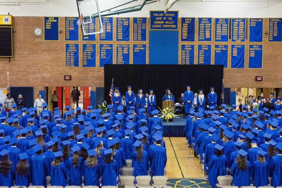 Graduate Lauren Curtis welcomes graduates and families to the graduation ceremony on Friday at Midland High School. Photo: Danielle McGrew Tenbusch