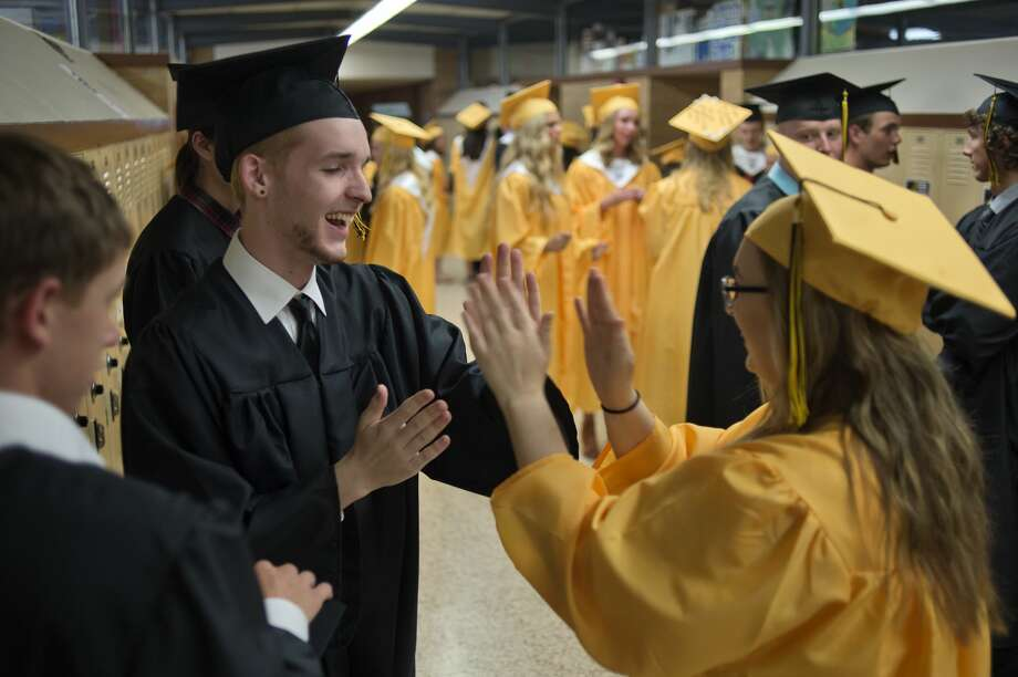 Bullock Creek High School graduates Jaden Baine, left, and Jazzmine Beeman play patty cake before the beginning of commencement at the school Friday evening. Photo: Brittney Lohmiller/Midland Daily News/Brittney Lohmiller