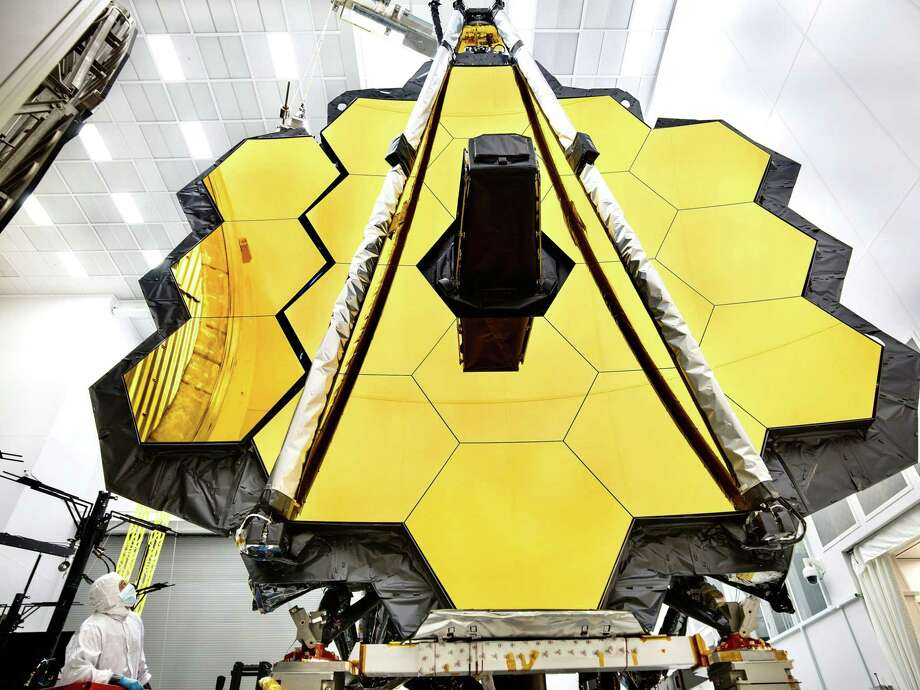 This NASA photo released on May 16, 2017 shows the primary mirror of NASA's James Webb Space Telescope inside a cleanroom at NASA's Johnson Space Center in Houston, where it will undergo its last cryogenic test before it is launched into space in 2018. (Photo by Chris Gunn/AFP/Getty Images) Photo: CHRIS GUNN / AFP or licensors