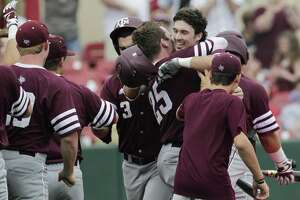 Texas A&M players come out to celebrate Braden Shewmake's (8) two-run homerun during the 2017 NCAA Regional game at Darryl and Lori Schroeder Park Friday, June 2, 2017, in Houston. ( Yi-Chin Lee / Houston Chronicle )