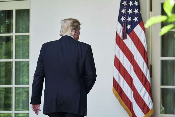 President Donald Trump exits following an announcement that the U.S. would withdraw from the Paris climate pact and that he will seek to renegotiate the international agreement. (T.J. Kirkpatrick/Bloomberg)