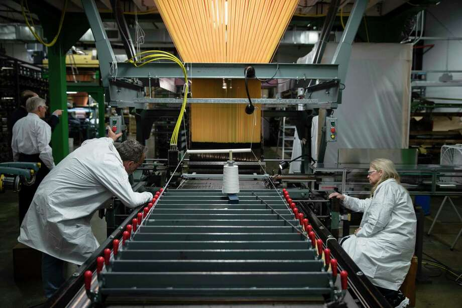 FILE - In this Thursday, March 23, 2017, file photo, workers manufacture thermal protection systems for NASA at Bally Ribbon Mills in Bally, Pa. U.S. employers pulled back on hiring in May 2017 by adding only 138,000 jobs. Hiring was still enough to help keep pushing unemployment lower. (AP Photo/Matt Rourke, File) Photo: Matt Rourke, STF / Copyright 2017 The Associated Press. All rights reserved.