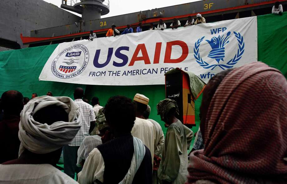 This file photo taken on March 19, 2017 shows Sudanese workers offloading U.S. aid destined for South Sudan from the World Food Programme (WFP) at Port Sudan. (Ashraf Shazly/AFP/Getty Images) Photo: ASHRAF SHAZLY, Stringer / AFP or licensors