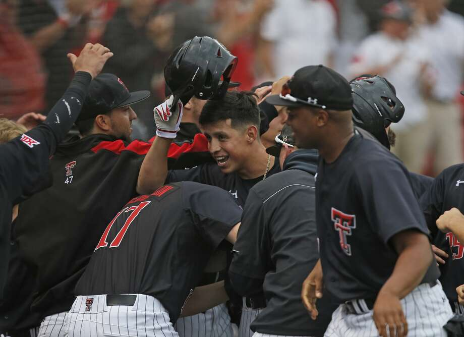 Texas Tech players celebrate with Orlando Garcia, center, after hitting a home run against Delaware during an NCAA college baseball regional game Friday, June 2, 2017, in Lubbock, Texas. (Brad Tollefson/Lubbock Avalanche-Journal via AP) Photo: Brad Tollefson/Associated Press