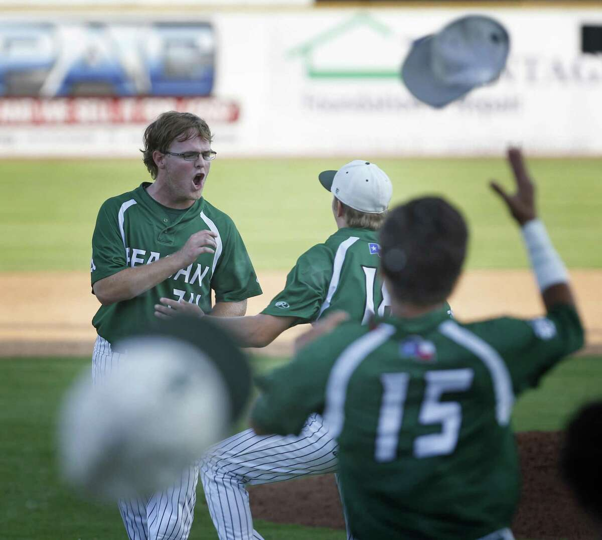 Reagan?•s Jake Hoggatt celebrates with Reagan?•s Cal Carver,winning pitcher,on right, after Reagan defeated Churchill 5-4 from Game 2 of the Region IV-6A final series between Churchill and Reagan at Wolff Stadium on Friday, June 2, 2017.
