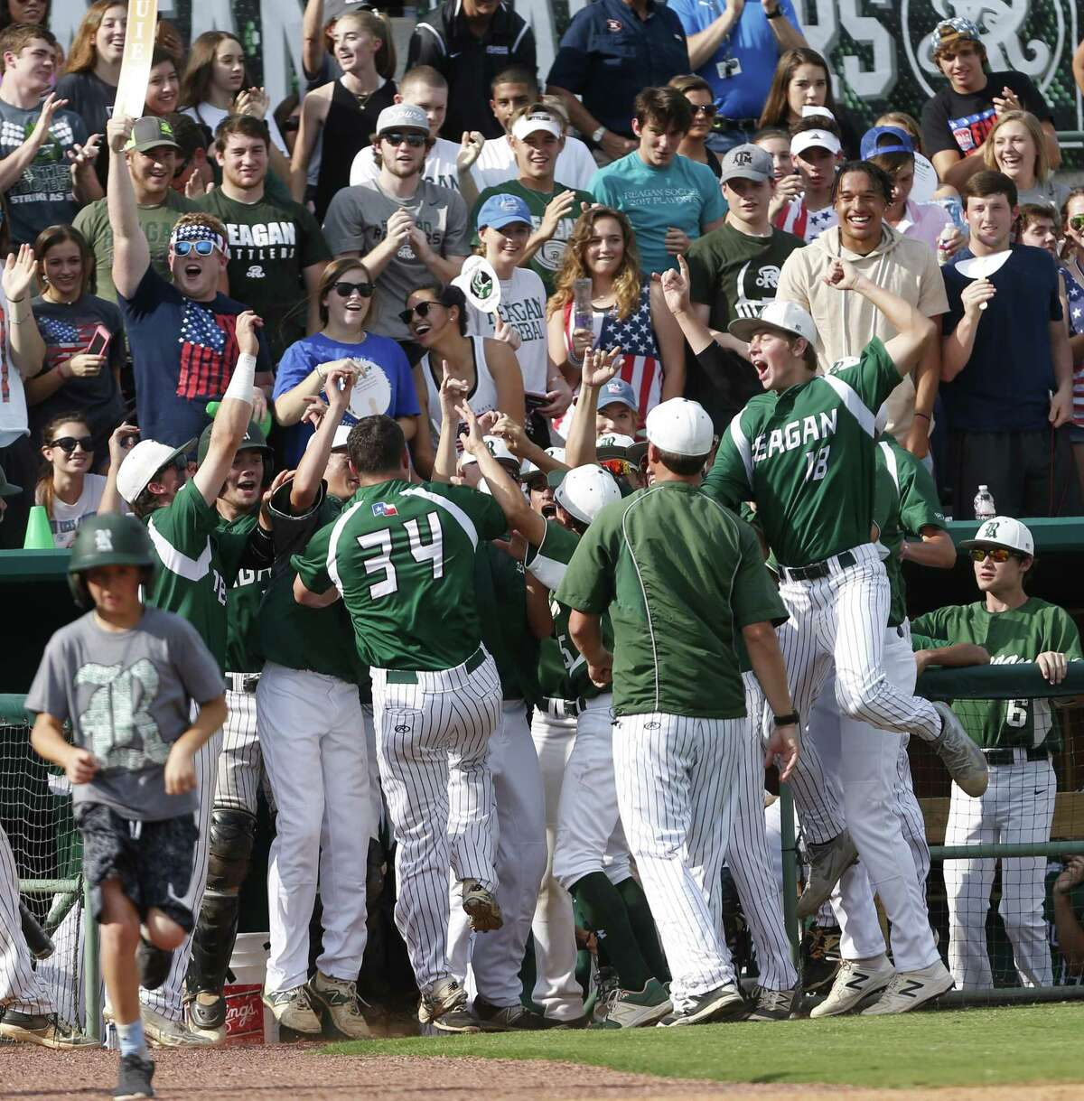 Reagan celebrates after Kyle Brookover (34) scored during Game 2 of a Region IV-6A final series against Churchill at Wolff Stadium on June 2, 2017.