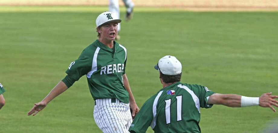 ReaganÕs Cal Carver celebrates with ReaganÕs Grant Ellis after the last out of the sixth inning from Game 2 of the Region IV-6A final series between Churchill and Reagan at Wolff Stadium on Friday, June 2, 2017. Photo: Ron Cortes, Freelance / For The San Antonio Express-News / Ronald Cortes / Freelance