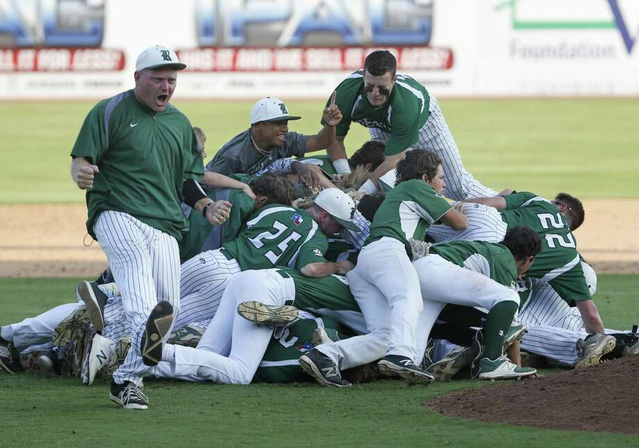 Reagan coach Chans Chapman celebrates along with his team after defeating Churchill 5-4 in Game 2 of the Region IV-6A final series at Wolff Stadium on June 2, 2017. Photo: Ron Cortes /For The Express-News / Freelance