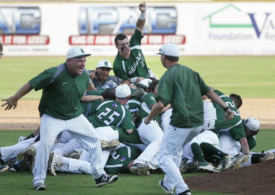 Reagan head coach Chans Chapman celebrates along with his team after defeating Churchill 5-4 from Game 2 of the Region IV-6A final series between Churchill and Reagan at Wolff Stadium on Friday, June 2, 2017. Photo: Ron Cortes / For The Express-News / Freelance