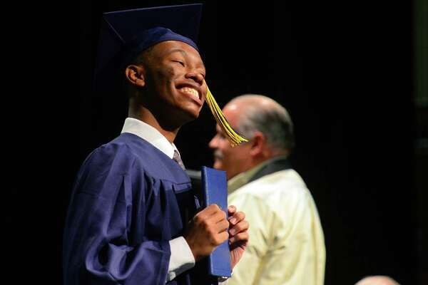 Graduate Jordan Crawford gives a big grin after getting his diploma during Notre Dame of Fairfield's Class of 2017 Commencement Exercises in Fairfield, Conn., on Friday June 2, 2017.