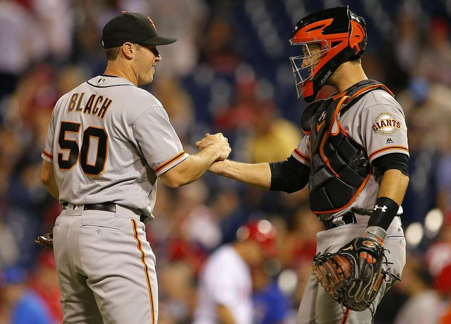 Giants starter Ty Blach is greeted by catcher Buster Posey after his first shutout. Blach threw a career-high 112 pitches. Photo: Rich Schultz, Getty Images