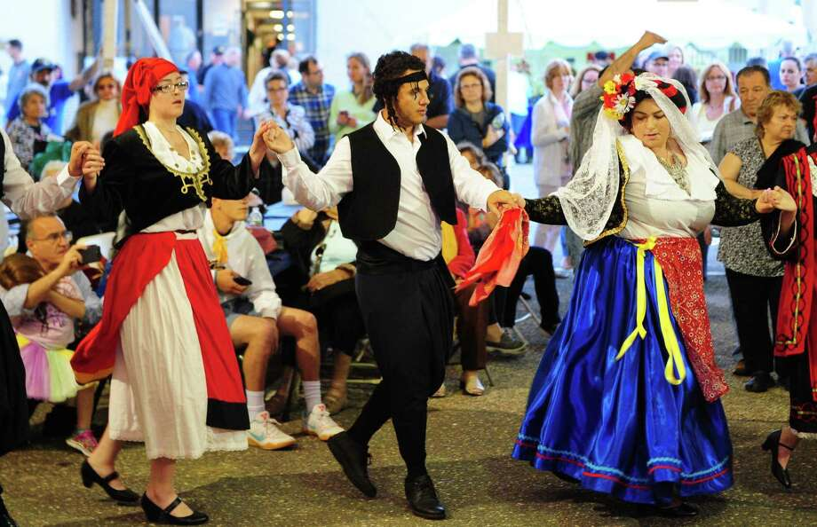 """Members of The Olympians dance group perform traditional Greek dances during Holy Trinity Greek Orthodox Church's """"Olympiad 2017 — Greek Festival and Fair"""" in Bridgeport on Friday. From left to right is Irene Bal, George Zahariadis and Effie Hallas. The festival continues Saturday and Sunday from 11 a.m. to 11 p.m. Photo: Christian Abraham / Hearst Connecticut Media / Connecticut Post"""
