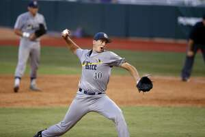 Rice pitcher Matt Canterino (40) pitches in the fourth inning of an NCAA college baseball tournament regional game against Southeastern Louisiana in Baton Rouge, La., Friday, June 2, 2017. (AP Photo/Gerald Herbert)