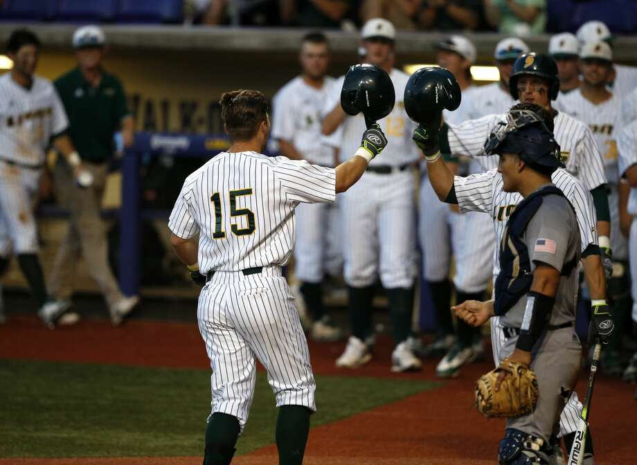 Southeastern Louisiana's Taylor Schwaner (15) is greeted after his solo homer in the third inning of an NCAA college baseball tournament regional game against Rice in Baton Rouge, La., Friday, June 2, 2017. (AP Photo/Gerald Herbert) Photo: Gerald Herbert/Associated Press