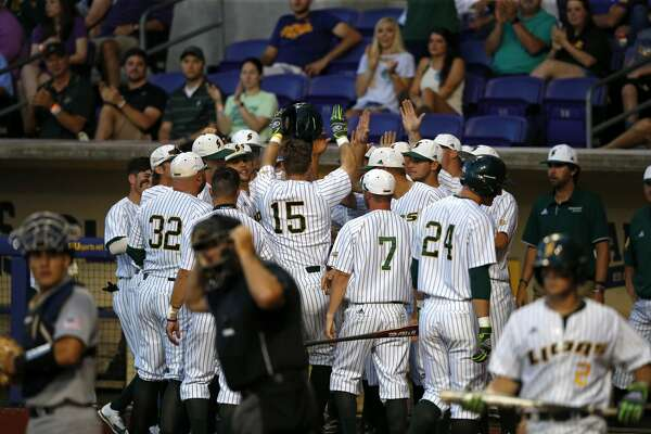 Southeastern Louisiana's Taylor Schwaner (15) is greeted after his solo homer in the third inning of an NCAA college baseball tournament regional game against Rice in Baton Rouge, La., Friday, June 2, 2017. (AP Photo/Gerald Herbert)
