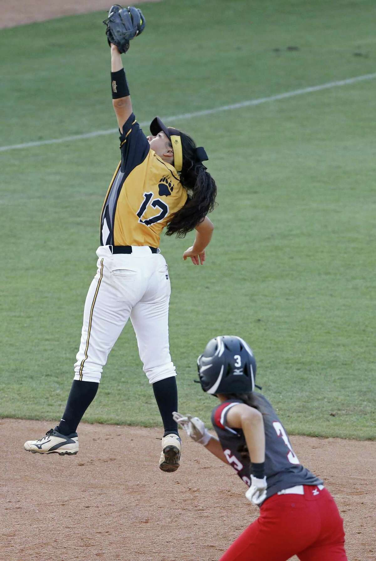Brennan?•s Gabriella Torres catches a liner with runners at first and second to end the 5th inning against Austin Bowie during their UIL Class 6A state semifinal game held Friday June 2, 2017 at Red & Charline McCombs Field in Austin, Tx. Austin Bowie won 2-1.