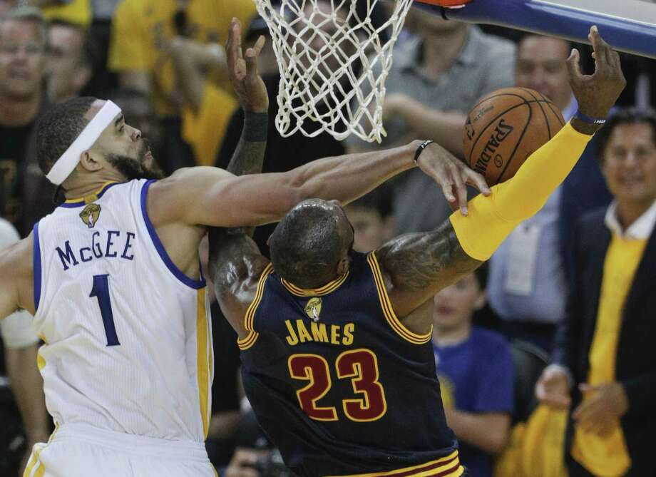 Golden State Warriors' JaVale McGee knocks away a Cleveland Cavaliers' LeBron James layup in the first quarter during Game 1 of the 2017 NBA Finals at Oracle Arena on Thursday, June 1, 2017 in Oakland, Calif. Photo: Carlos Avila Gonzalez / The Chronicle / online_yes