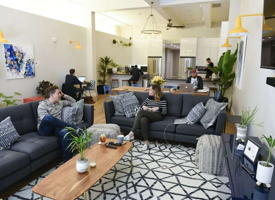 People work and relax in the main shared living area of Starcity's newly finished building at 2072 Mission St. Photo: Michael Short / Michael Short / Special To The Chronicle / Michael Short 2017