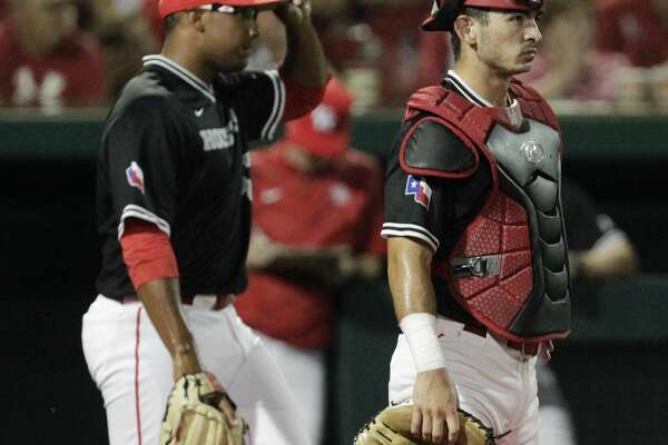 Houston pitcher Aaron Fletcher (47) and catcher Connor Wong (10) react to allowing a run with a wild pitch during eighth inning of the 2017 NCAA Regional game against the Iowa at Darryl and Lori Schroeder Park Friday, June 2, 2017, in Houston. ( Yi-Chin Lee / Houston Chronicle )