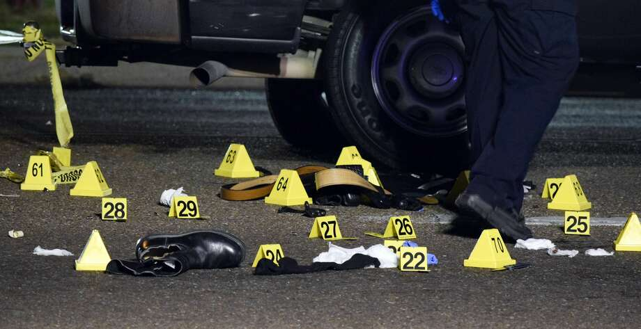 In this file photo, the Laredo Police Department analyzes the scene of a crime. Photo: Ulysses S. Romero/Laredo Morning Times