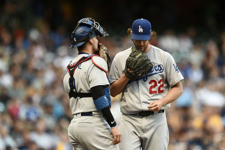 MILWAUKEE, WI - JUNE 02:  Clayton Kershaw #22 of the Los Angeles Dodgers speaks with Yasmani Grandal #9 during the first inning of a game against the Milwaukee Brewers at Miller Park on June 2, 2017 in Milwaukee, Wisconsin.  (Photo by Stacy Revere/Getty Images) Photo: Stacy Revere/Getty Images