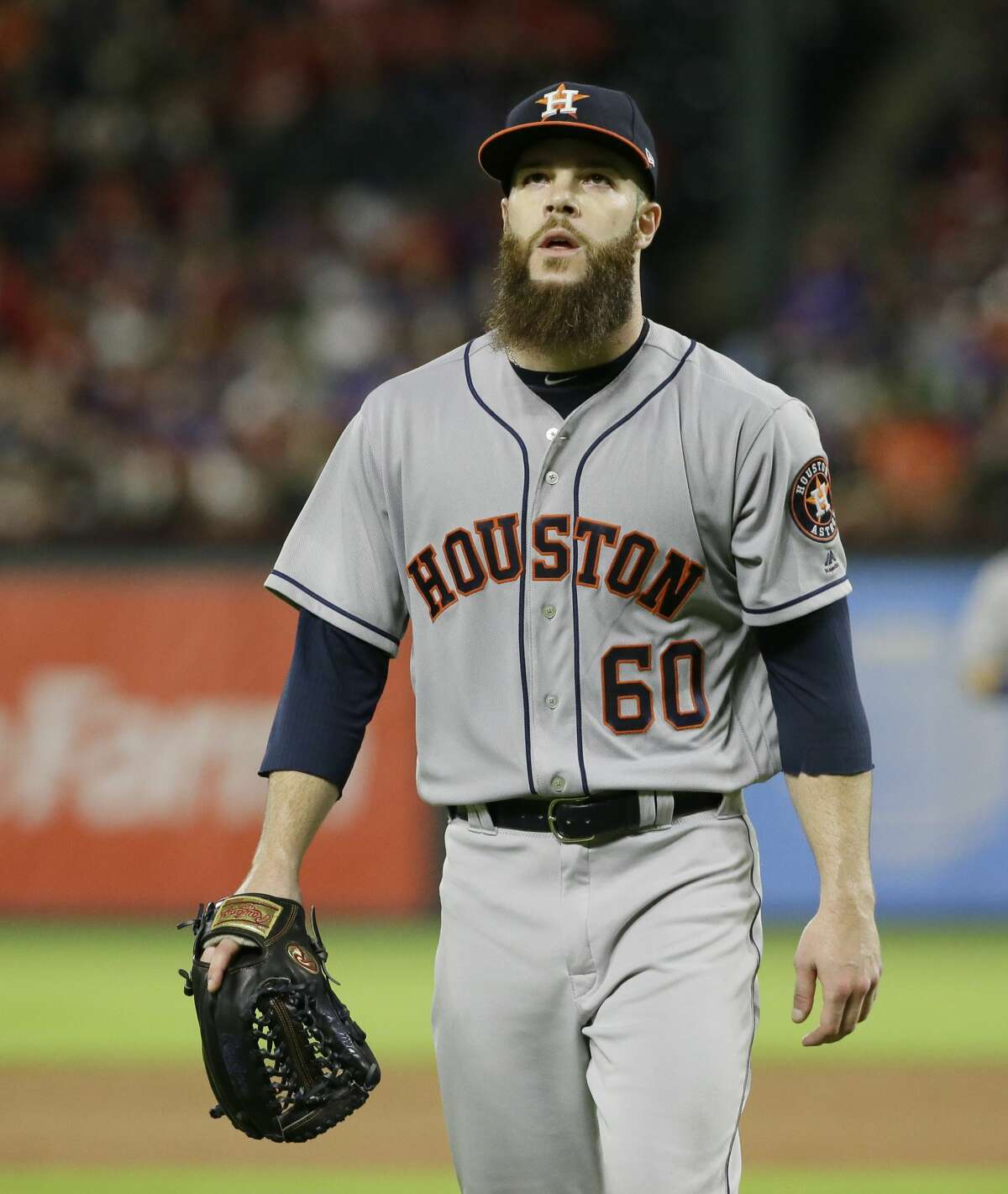 Houston Astros starting pitcher Dallas Keuchel walks off the field after the final out of the fourth inning of a baseball game against the Texas Rangers in Arlington,Texas, Friday, June 2, 2017. (AP Photo/LM Otero)