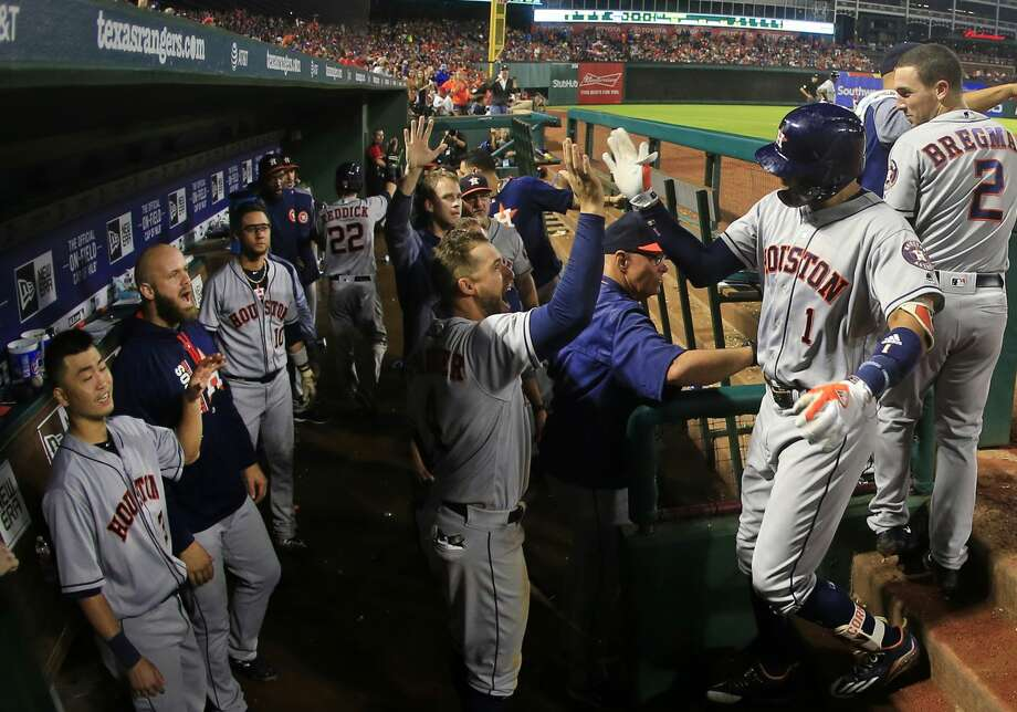 ARLINGTON, TX - JUNE 2: Carlos Correa #1 of the Houston Astros celebrates his three-run home run with teammates as the Astros take on the Texas Rangers during the fifth inning at Globe Life Park in Arlington on June 2, 2017 in Arlington, Texas. (Photo by Ron Jenkins/Getty Images) Photo: Ron Jenkins/Getty Images