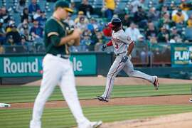 OAKLAND, CA - JUNE 02:  Michael Taylor #3 of the Washington Nationals rounds the bases after hitting a home run off of Andrew Triggs #60 of the Oakland Athletics during the second inning at the Oakland Coliseum on June 2, 2017 in Oakland, California. (Photo by Jason O. Watson/Getty Images)