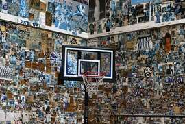 Photos and clippings cover the gym wall at the Ingleside Presbyterian Church and Community Center.