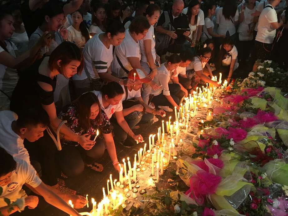 Mourners light candles at a memorial to victims of the attack on the Resorts World Manila complex. Photo: Todd Pitman, Associated Press