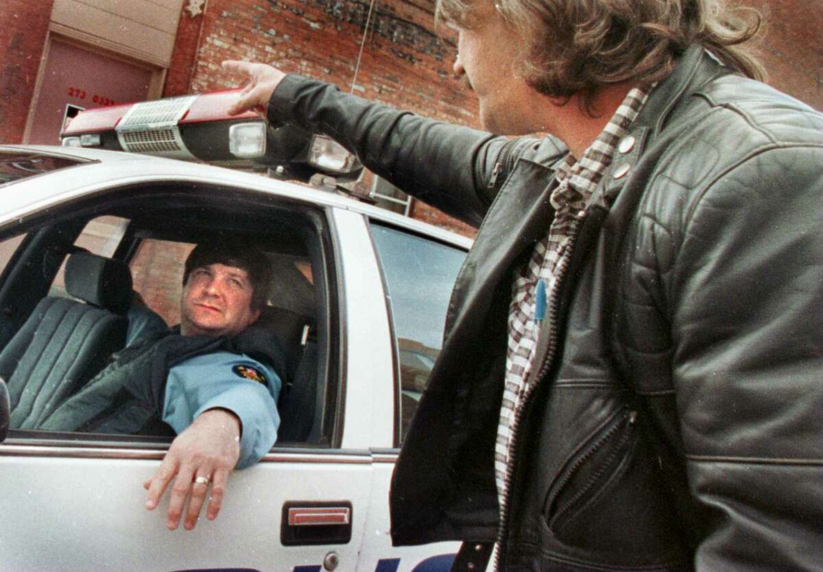 Former Troy police Officer Richard Schoonmaker, left, in his patrol car in a North Troy neighborhood, Schoonmaker retired from the Troy police force in 2009. He has accused the Galway police chief of firing him for reporting police misconduct. (Times Union archive)