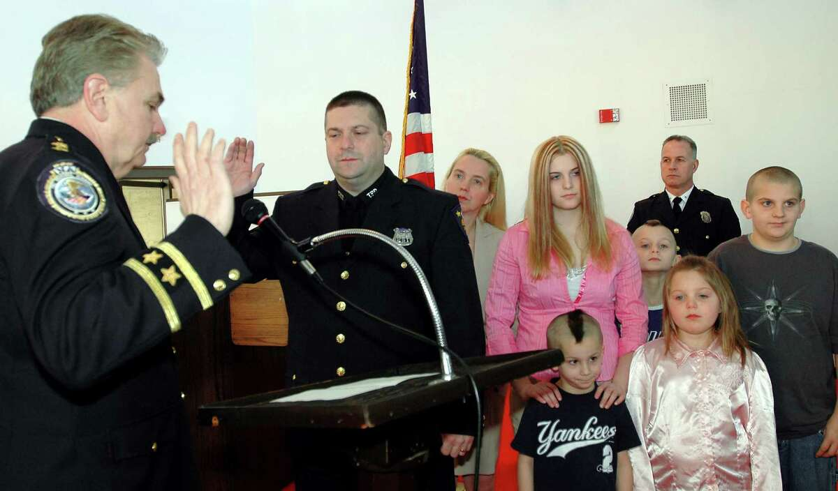 Former Troy police Officer Richard Schoonmaker, Sr., right, during a ceremony in 2005 when he was promoted to the rank of sergeant. (Times Union archive)