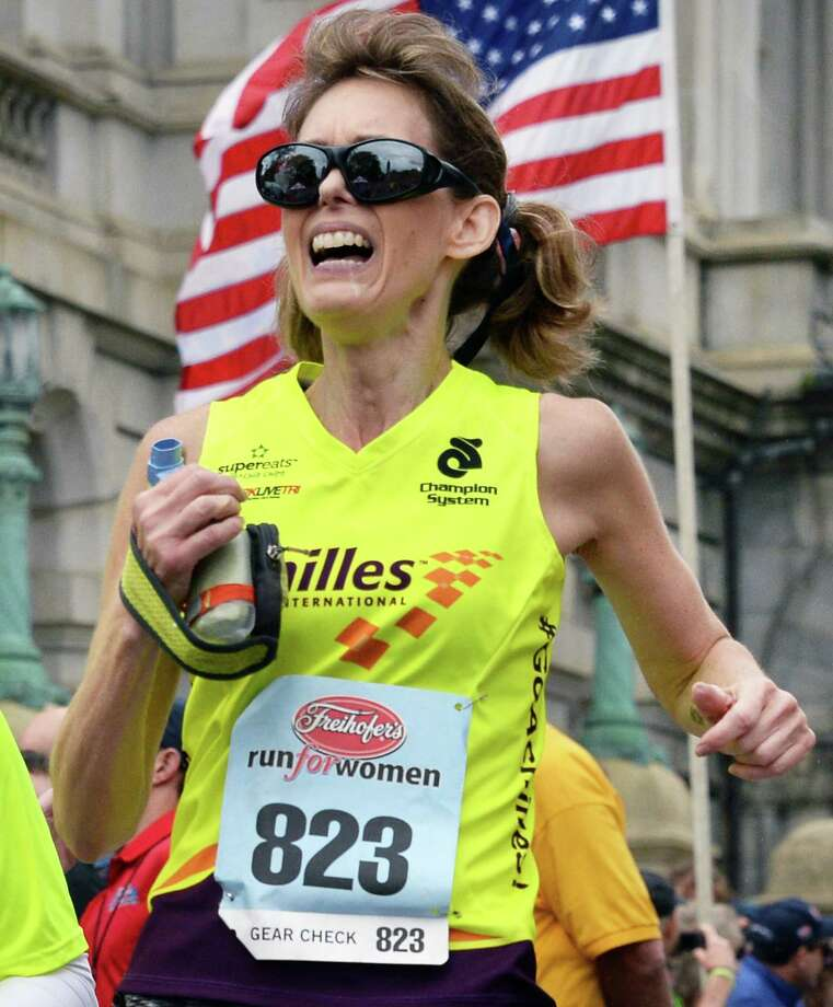 Visually impaired runner Kathleen Rogan of Kingston finishes the Freihofer's Run for Women Saturday June 3, 2017 in Albany, NY.  (John Carl D'Annibale / Times Union) Photo: John Carl D'Annibale / 40040636A