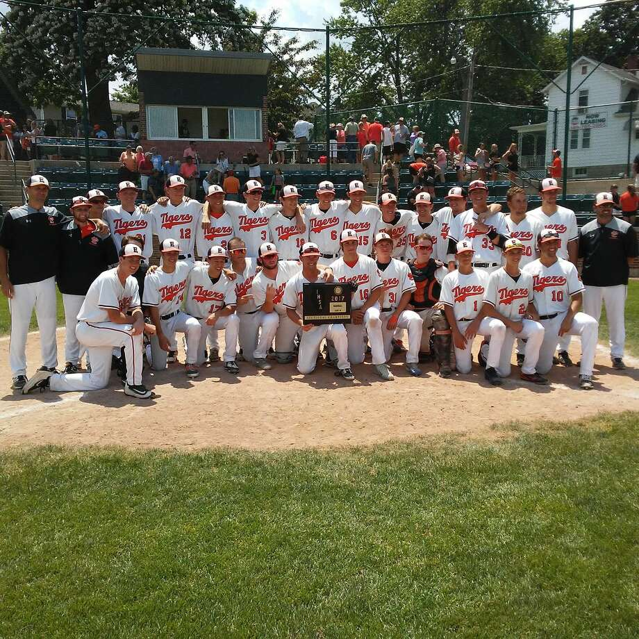The Edwardsville Tigers pose with the championship plaque after beating Normal West on Saturday in the title game of the Class 4A Bloomington (Illinois Wesleyan) Sectional.