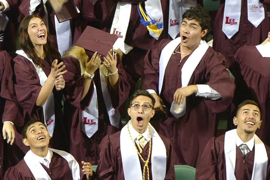Lee High School graduates throw their caps during the commencement ceremony June 3, 2017, at Chaparral Center.  James Durbin/Reporter-Telegram Photo: James Durbin