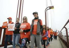 Demonstrators walk across the Golden Gate Bridge during a march against gun violence in San Francisco, Calif. on Saturday, June 3, 2017.