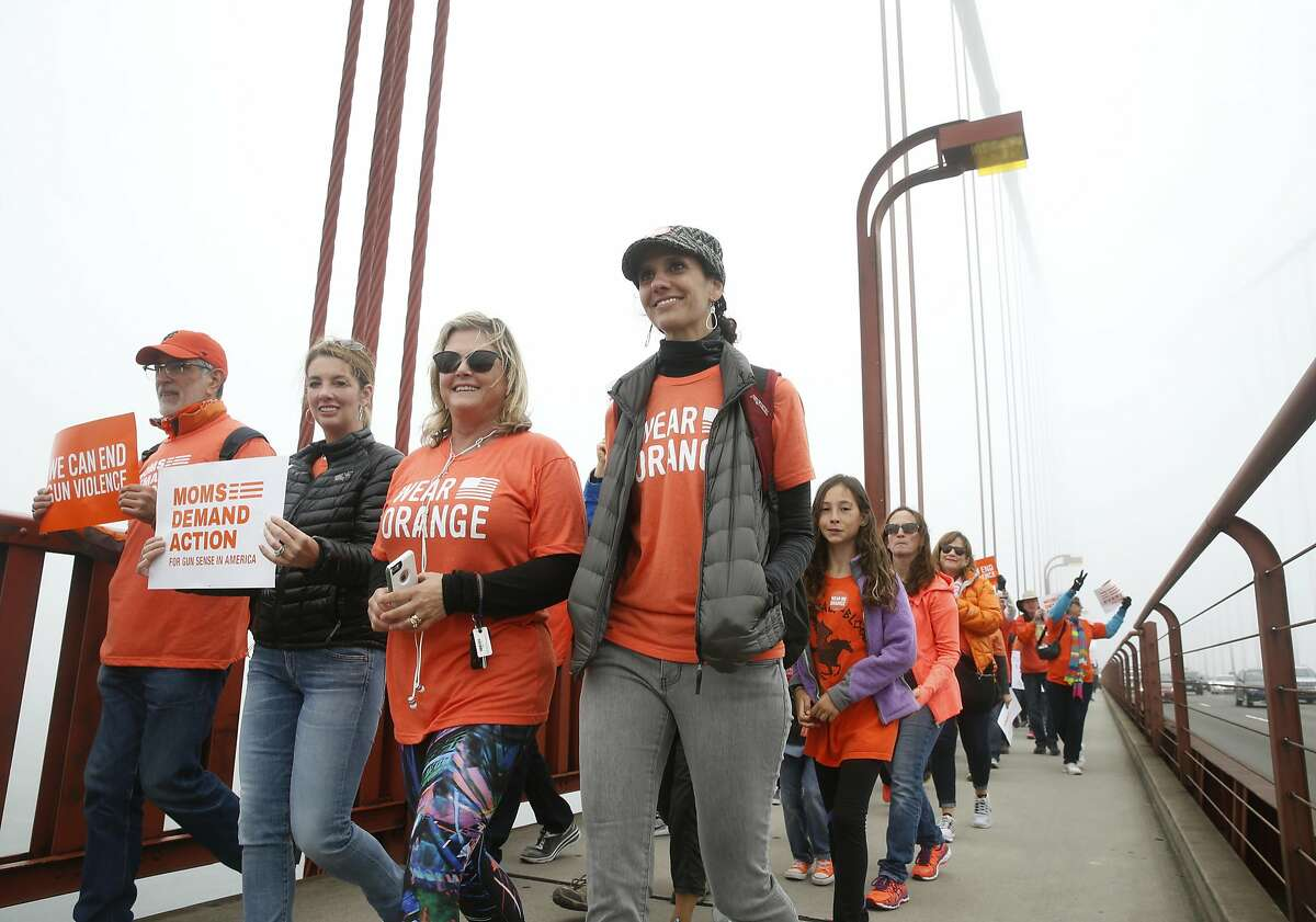 Demonstrators walk across the Golden Gate Bridge during a march against gun violence in San Francisco, Calif. on Saturday, June 3, 2017.