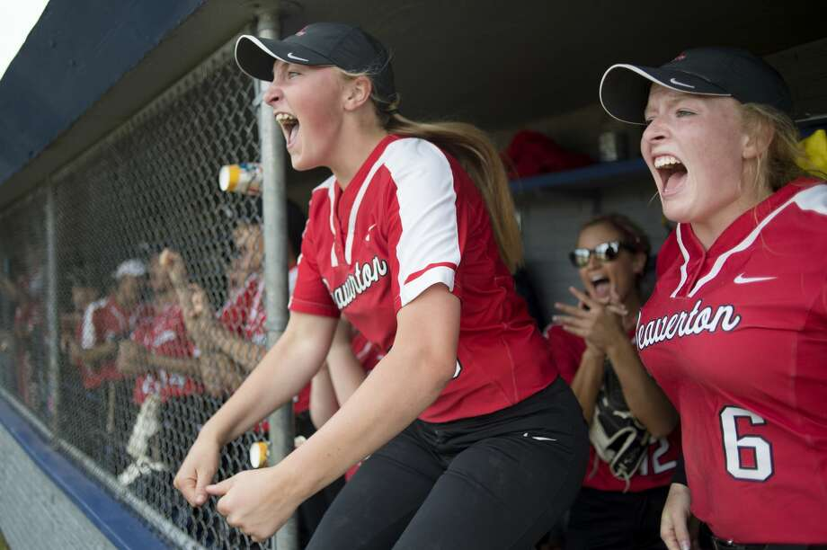 Beaverton's Ann-Marie Hicks, left, and Faith Howe celebrate as Maddy Krauss scores Beaverton's second run in the fourth inning of Beaverton's game against Farwell in the Division 3 softball tournament Saturday morning. Beaverton defeated Farwell 3-0. Photo: Brittney Lohmiller/Midland Daily/Brittney Lohmiller