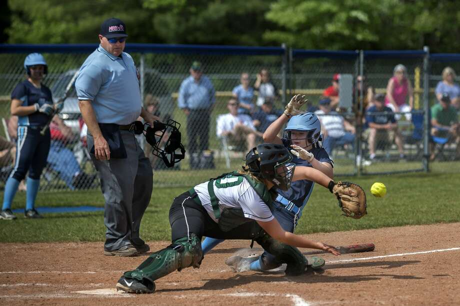 Meridian's Kassidy Zmikly slides into home plate in the fifth inning scoring Meridian's third run of their game against Clare in the Division 3 softball tournament Saturday morning. Meridian defeated Clare 8-4. Photo: Brittney Lohmiller/Midland Daily/Brittney Lohmiller