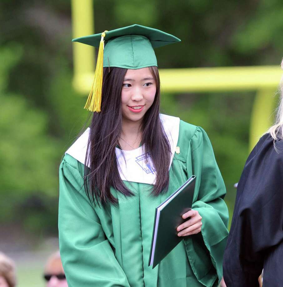 University of Washington-bound she said, Xuanming Da, 19, of Stamford, receives her Trinity Catholic High School dipolma during the commencement at the school in Stamford, Conn., Saturday, June 3, 2017. Photo: Bob Luckey Jr. / Hearst Connecticut Media / Greenwich Time