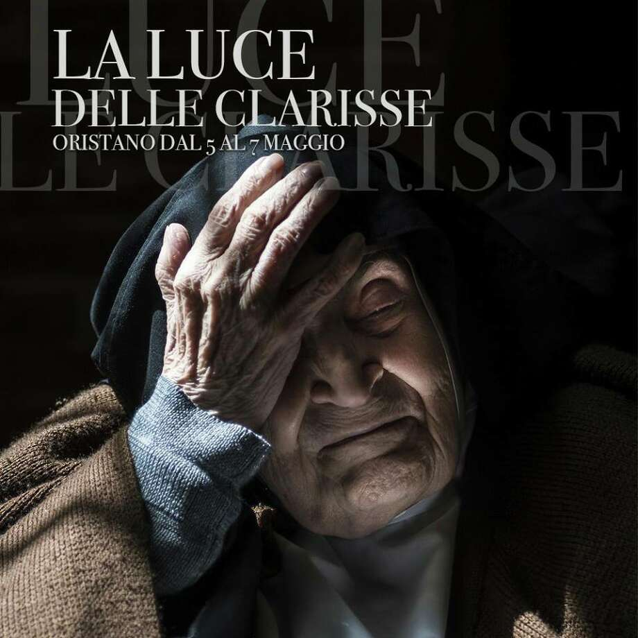 "The poster for the photo exhibition ""La Luce delle Clarisse"" (The light of the Clarissa nuns) featured 88-year-old Sister Chiara Maria. Photo: RNS"