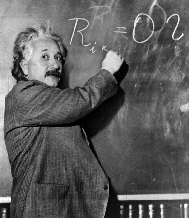 FILE--Albert Einstein writes out an equation for the density of the Milky Way on the blackboard at the Carnegie Institute, Mt. Wilson Observatory headquarters in Pasadena, Calif. in this Jan. 14, 1931 file photo. In the only study ever conducted of the overall anatomy of Einstein's brain, to be published in this week's issue of The Lancet, a British medical journal, scientists at McMaster University in Ontario, Canada, discovered that the part of the brain thought to be related to mathematical reasoning _ the inferior parietal region _ was 15 percent wider on both sides than normal, making Einstein's brain anatomically distinct.(AP Photo/File)   HOUCHRON CAPTION (01/02/2000):  Albert Einstein writes an equation for the density of the Milky Way at the Carnegie Institute, Mt. Wilson Observatory in Pasadena, Calif., in 1931. Time magazine named Einstein Person of the Century.  HOUCHRON CAPTION (01/09/2005) SECOUTLOOK:   A BEAUITFUL MIND?: Albert Einstein writes an equation for the density of the Milky Way at the Carnegie Institute, Mount Wilson Observatory in Pasadena, Calif., in 1931. / AP