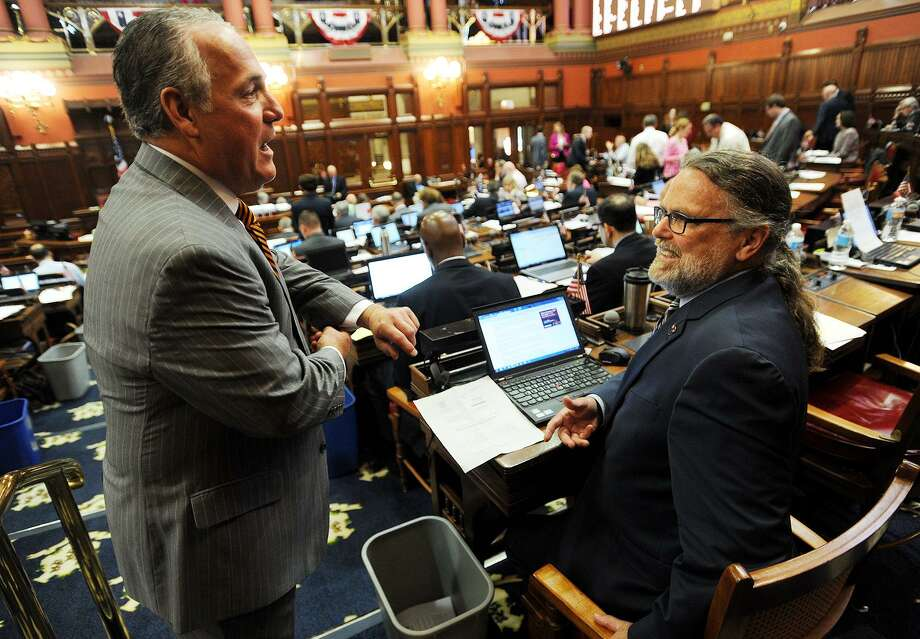 Rep. Jeff Berger, D-Waterbury, left, chats with Rep. Jack Hennessy, D- Bridgeport, in the House chambers at the Capitol in Hartford, Conn. on Thursday, June 1, 2017. Photo: Brian A. Pounds / Hearst Connecticut Media / Connecticut Post
