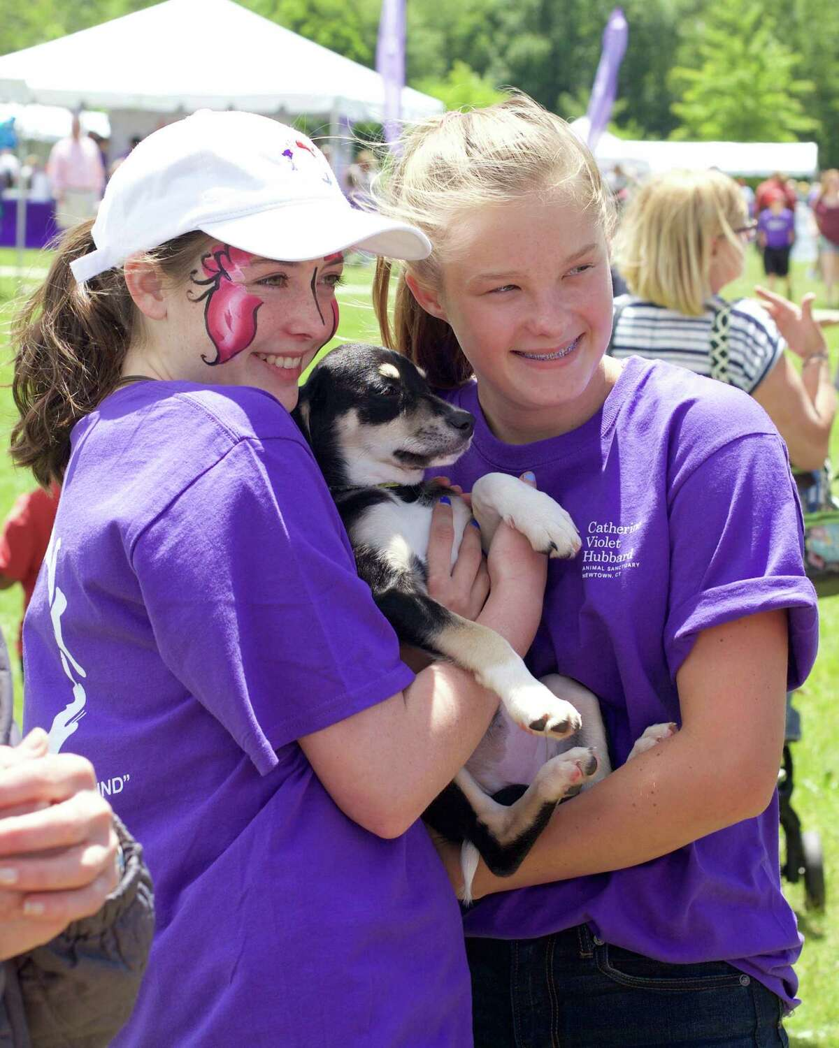 Volunteers Kaitlyn King and Olivia Grant (both 14 from Newtown) posing with a shepherd husky mix for adoption during the 3rd Annual Catherine's Butterfly Party on Saturday, June 3, 2017 from 12-4 at the Fairfield Hills Campus in Newtown.