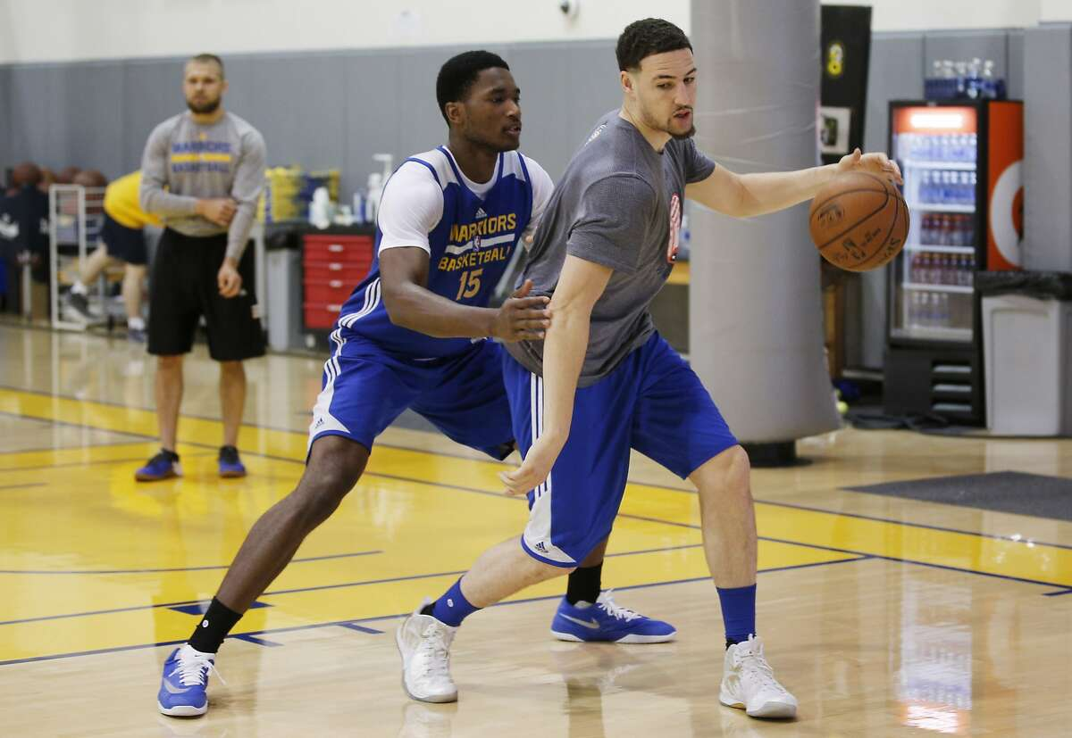 Golden State Warriors guard Klay Thompson (11) and center Damian Jones (15) at the Warriors practice facility on Saturday, June 3, 2017, in Oakland, Calif. In the NBA Finals, the Warriors lead the series 1-0 against the Cleveland Cavaliers. They play Game 2 on Sunday.