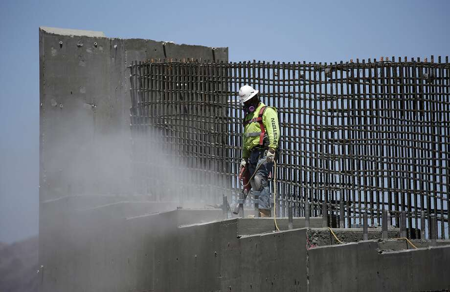 A man works on Interstate 11 near Boulder City, Nev. President Trump will outline his infrastructure package this week. Photo: John Locher, Associated Press