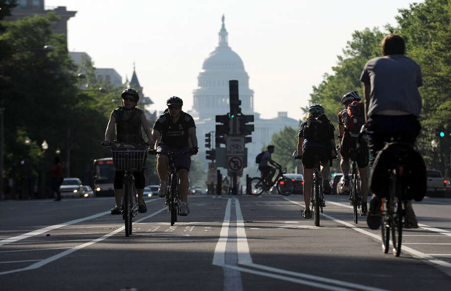 Commuters use the bike lanes on Pennsylvania Avenue in Washington, D.C. From 2001 to 2009, the number of bike miles traveled annually by people 45 and older nearly doubled to 3.6 trillion. Photo: Astrid Riecken / Astrid Riecken
