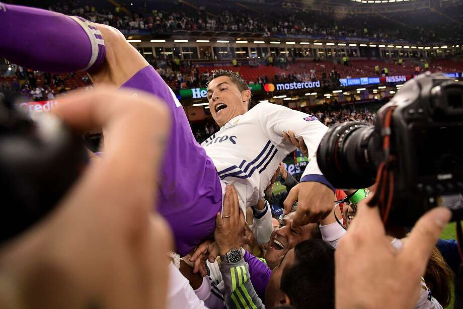 Real Madrid's Portuguese striker Cristiano Ronaldo is thrown into the air for celebration after Real Madrid won the UEFA Champions League final football match between Juventus and Real Madrid at The Principality Stadium in Cardiff, south Wales, on June 3, 2017. / AFP PHOTO / JAVIER SORIANOJAVIER SORIANO/AFP/Getty Images Photo: JAVIER SORIANO, AFP/Getty Images