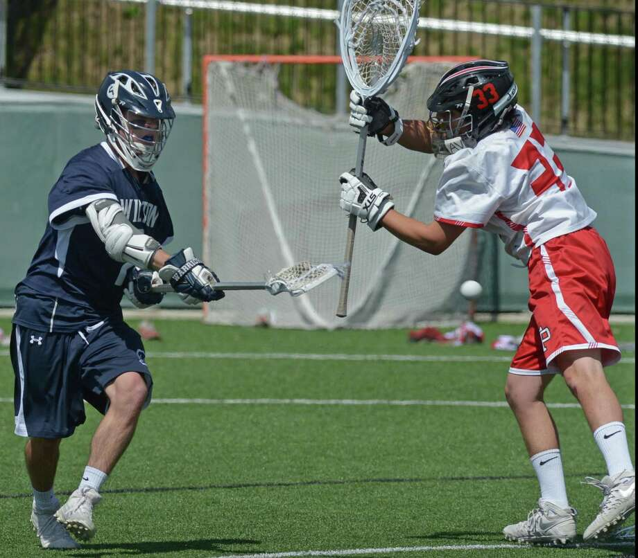 #2 for Wilton High School Brian Calabrese scores past #33 for Fairfield Prep Matthew Pinho during their Class L Boys Lacrosse game Saturday, June 3, 2017, at Fairfield University in Fairfield, Conn. Photo: Erik Trautmann / Hearst Connecticut Media / Connecticut Post